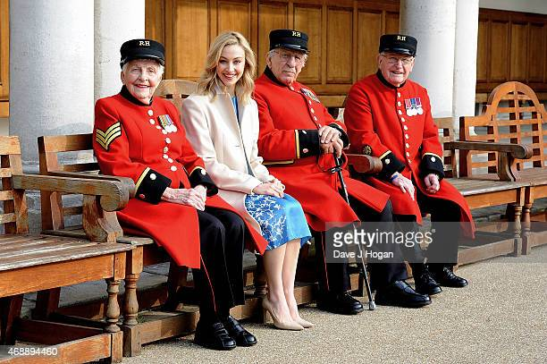 Sarah Gadon who plays Princess Elizabeth in 'A Royal Night Out' with Dorothy Hughes Harry Puttick and Frank Mouque visits the Chelsea Pensioners to...