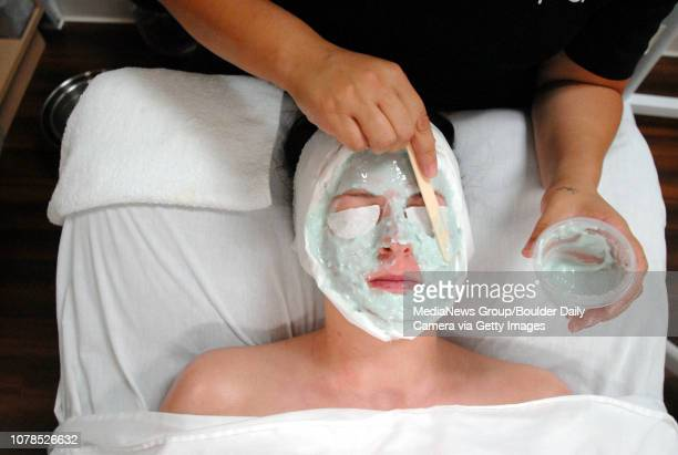 Sarah Gehringer has a mask applied by esthetician Melissa Martinez at Face Logic on Thursday.