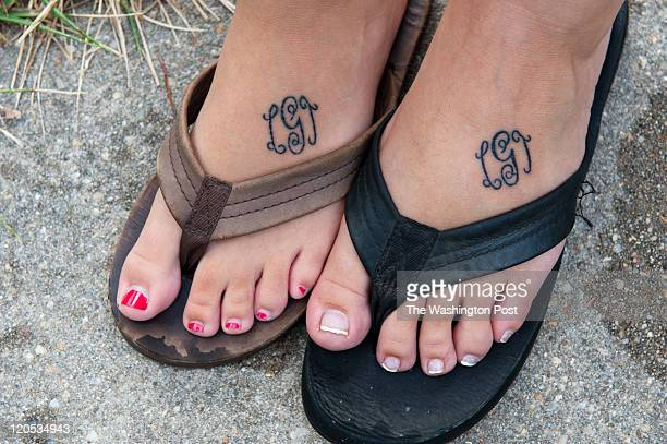 Sarah Giddings and Kaitlyn Wheeler had their feet tattooed with their sister Lauren's initials after learning of their sister's death in Laurel...
