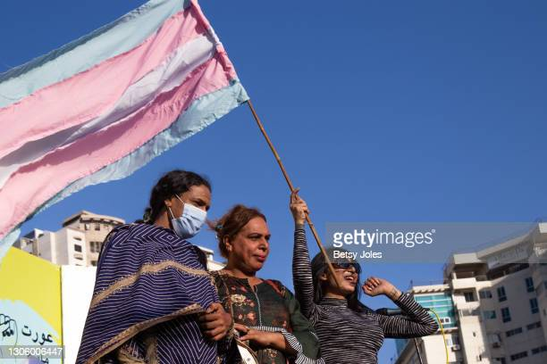 Sarah Gill, a trans activist, stands on stage with other members of the trans community at the Aurat March for International Women's Day on March 08,...