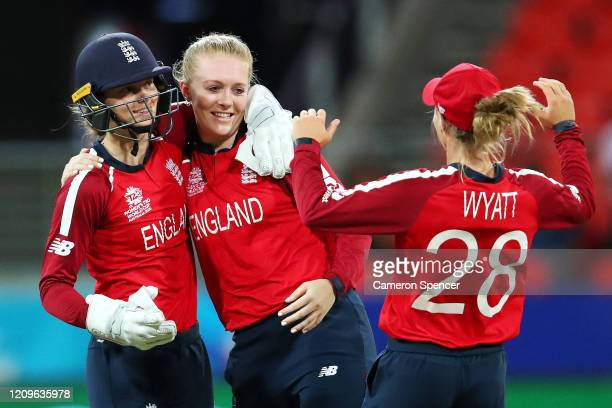 Sarah Glenn of England celebrates with Amy Jones of England and Danielle Wyatt of England after dismissing Hayley Matthews of West Indies during the...