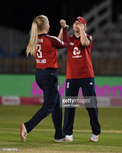 Sarah Glenn of England celebrates with Heather Knight after dismissing Stafanie Taylor of the West Indies during the 1st Vitality IT20 between...