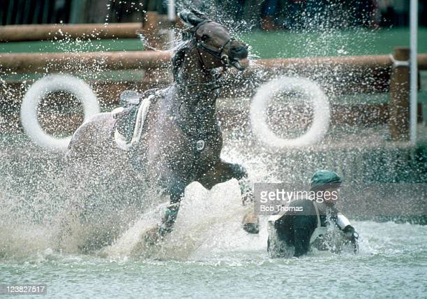 Sarah Gordon of Great Britain falls from her horse Rattakenny during the Badminton Horse Trials circa April 1985