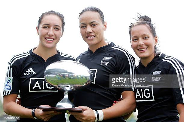 Sarah Goss Honey Hireme and Tyla NathanWong of New Zealand pose with the Cup Trophy after victoty in the IRB Women's Sevens World Series match...