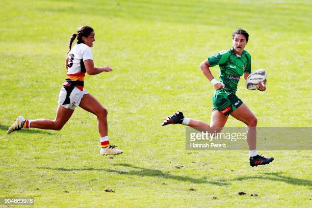 Sarah Goss of Manawatu makes a break during the Bayleys National Sevens Women's Cup Final match between Manawatu and Waikato at Rotorua International...