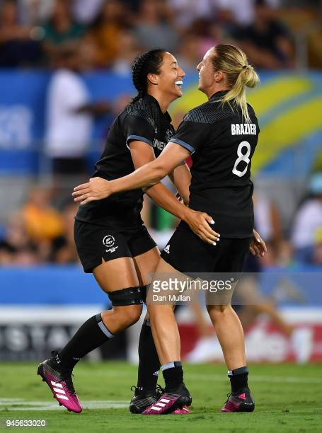 Sarah Goss of New Zealand celebrates scoring a try with Kelly Brazier of New Zealand during the Rugby Sevens Women's Pool A match between New Zealand...