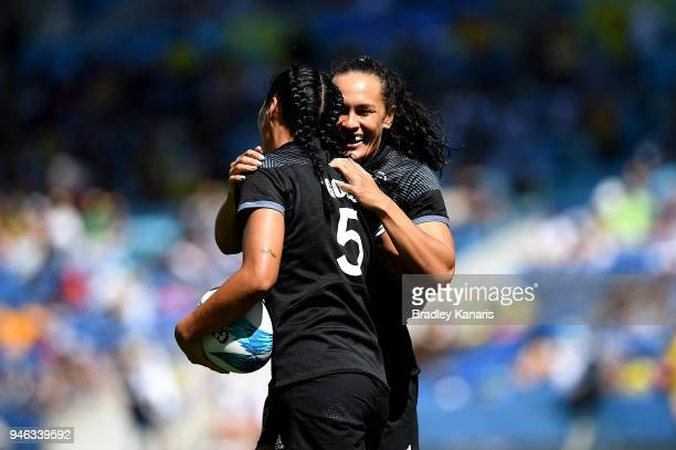 Sarah Goss of New Zealand celebrates with team mate Portia Woodman after scoring a try in the match between New Zealand and England during Rugby...