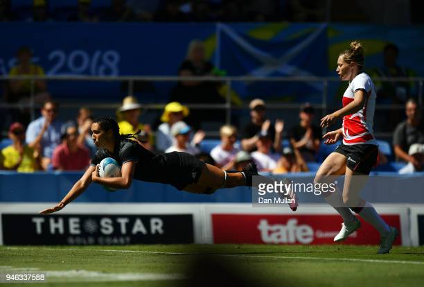 Sarah Goss of New Zealand dives over for a try during the Rugby Sevens Women's Semi-Final between New Zealand and England on day 11 of the Gold Coast...