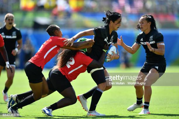 Sarah Goss of New Zealand is tackled by Philadelphia Olanda of Kenya during the Women's Rugby Sevens Pool B match between New Zealan and Kenya on Day...