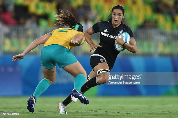 Sarah Goss of New Zealand is tackled by Shami Williams of Australia during the Women's Gold Medal Rugby Sevens match between Australia and New...