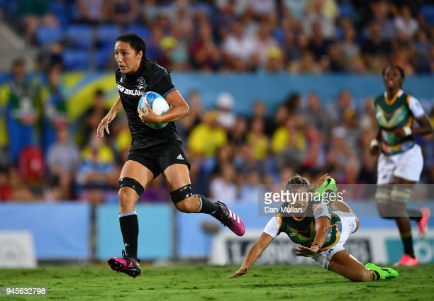 Sarah Goss of New Zealand makes a break to score a try during the Rugby Sevens Women's Pool A match between New Zealand and South Africa on day nine...