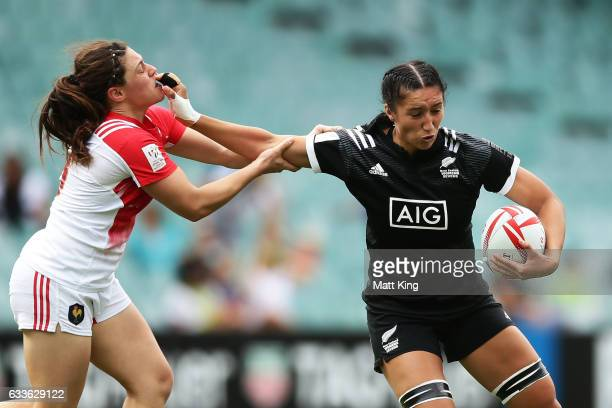 Sarah Goss of New Zealand puts a fend on Chloe Pelle of France during the womens pool match between England and USA in the 2017 HSBC Sydney Sevens at...