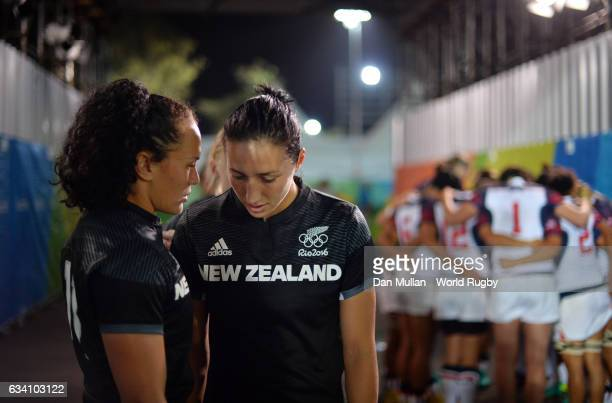 Sarah Goss of New Zealand talks with Portia Woodman of New Zealand as the United States team huddle prior to the Women's Rugby Sevens Quarter Final...