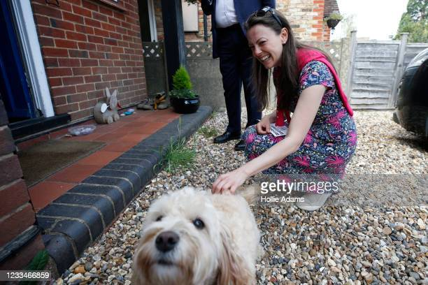 Sarah Green, candidate for Chesham and Amersham, pets a dog while out canvassing with Ed Davey, Leader of the Liberal Democrats, on June 15, 2021 in...