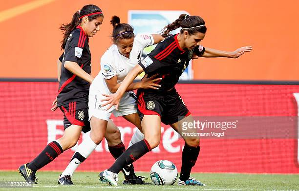 Sarah Gregorius of New Zealand Kenti Robles and Natalia Garcia of Mexico battle for the ball during the FIFA Women's World Cup 2011 Group B match...
