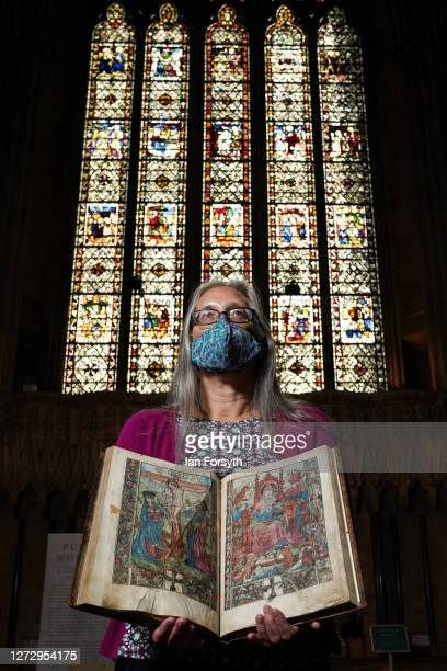 Sarah Griffin York Minster Librarian poses with the Slashed Missal a service and prayer book written in France in 1505 and which is displayed as part...