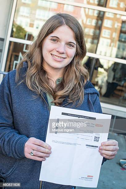 Sarah Grzywacz holds up her ticket for 'The Interview' during Sony Pictures' release of 'The Interview' at the Plaza Theatre on Christmas Day...