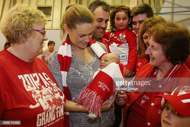 Sarah Haberman introduces 2 week old son Lucas as the newest member of the cheersquad during the creation of the Sydney Swans AFL banner at Glenroy...