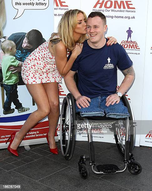 Sarah Harding and Private Michael Swain attend a photocall to launch the Coming Home lottery ticket at Hippodrome Casino on October 30 2013 in London...