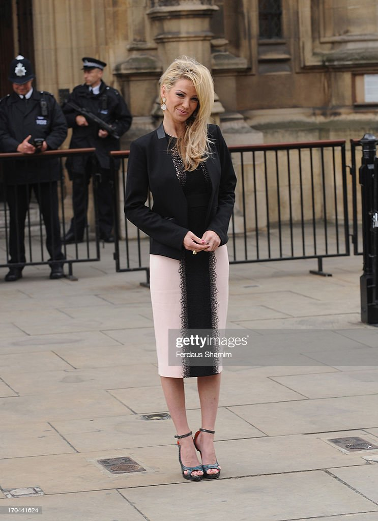 Sarah Harding poses as she makes a visit in her role as ambassador for the Coming Home charity at House of Commons on June 13, 2013 in London, England.