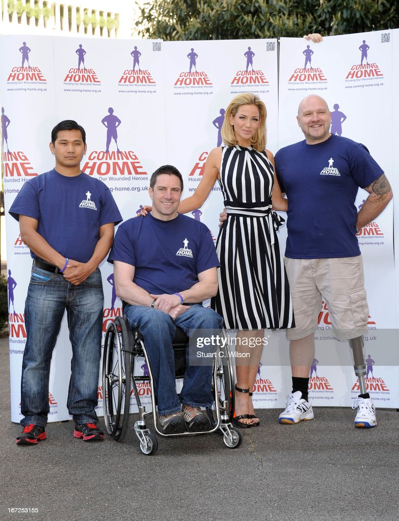 Sarah Harding poses with Tirthraj Thapa, Talan Skeels-Piggins and Richard Hunt as she is unveiled as the new ambassador for the armed forces charity 'Coming Home' at Royal College Of Defence Studies on April 23, 2013 in London, England.