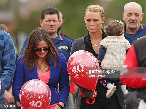 Sarah Harper the girlfriend of Christopher Lane holds Chris's niece Amelia while Erin Lane sister of Christopher Lane looks on as they prepare to...