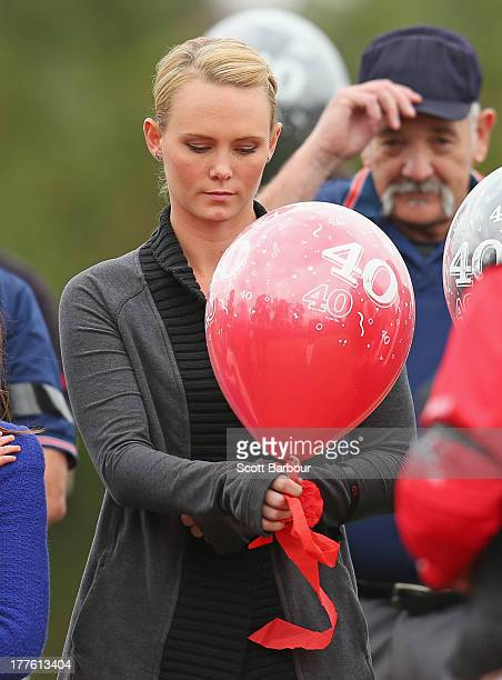 Sarah Harper the girlfriend of Christopher Lane releases a balloon to celebrate Lane's life during the Chris Lane Memorial Game at the Essendon...