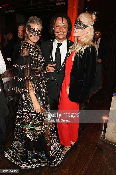 Sarah Harris Alfie Hollingsworth and Poppy Delevingne attend Eva Cavalli's birthday dinner party at One Mayfair on October 9 2015 in London England
