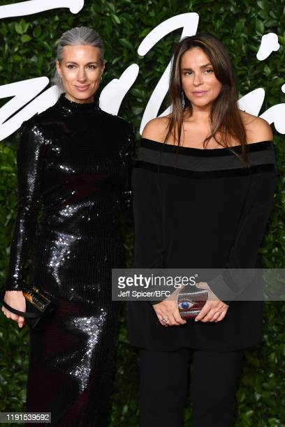 Sarah Harris and Celia Kritharioti arrive at The Fashion Awards 2019 held at Royal Albert Hall on December 02 2019 in London England