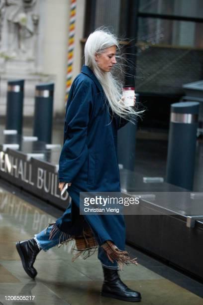 Sarah Harris is seen wearing navy coat outside David Koma during London Fashion Week February 2020 on February 15 2020 in London England