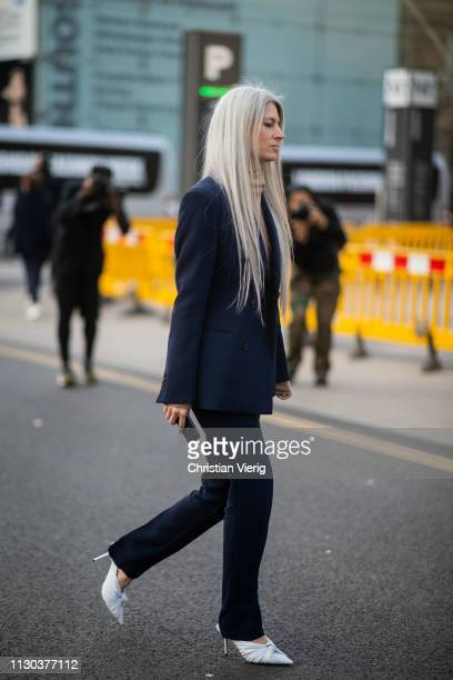 Sarah Harris is seen wearing navy suit outside Margaret Howell during London Fashion Week February 2019 on February 17 2019 in London England