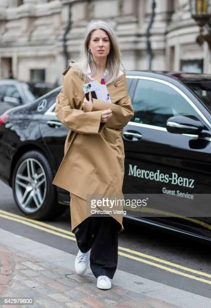 Sarah Harris wearing a beige coat, black wide leg pants outside Preen by Thornton Bregazzi on day 3 of the London Fashion Week February 2017...