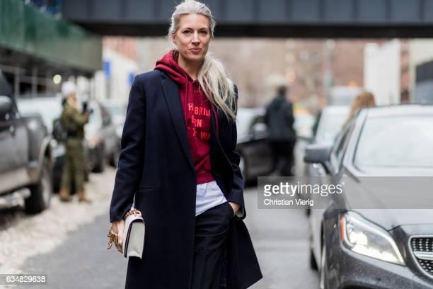 Sarah Harris wearing a Vetements hoody wool coat outside Tibi on February 11 2017 in New York City