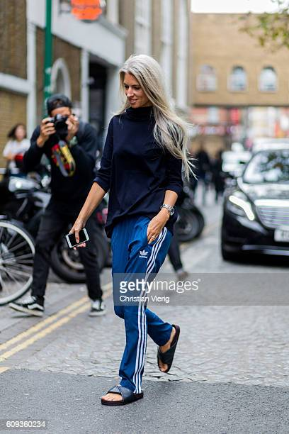 Sarah Harris wearing blue Adidas jogger pants outside Marques Almeida during London Fashion Week Spring/Summer collections 2017 on September 20 2016...