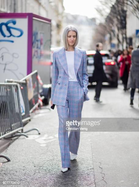 Sarah Harris wearing blue plaid suit is seen outside Sacai during Paris Fashion Week Womenswear Fall/Winter 2018/2019 on March 5 2018 in Paris France