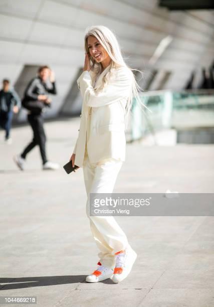 Sarah Harris wearing white suit sneakers is seen outside Giambattista Valli during Paris Fashion Week Womenswear Spring/Summer 2019 on October 1 2018...