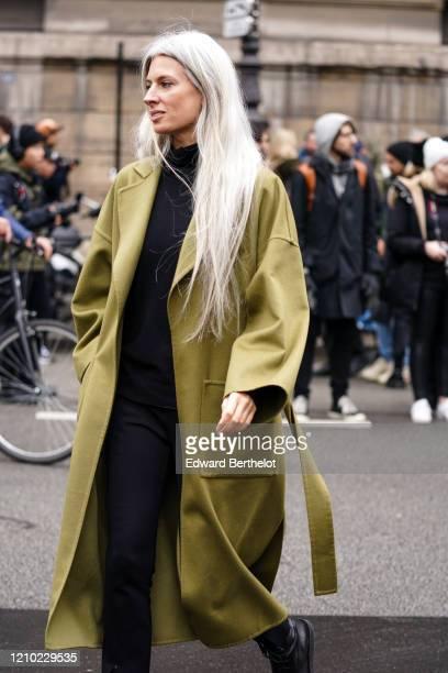 Sarah Harris wears a black turtleneck black pants a mustardyellow oversized coat outside Akris during Paris Fashion Week Womenswear Fall/Winter...