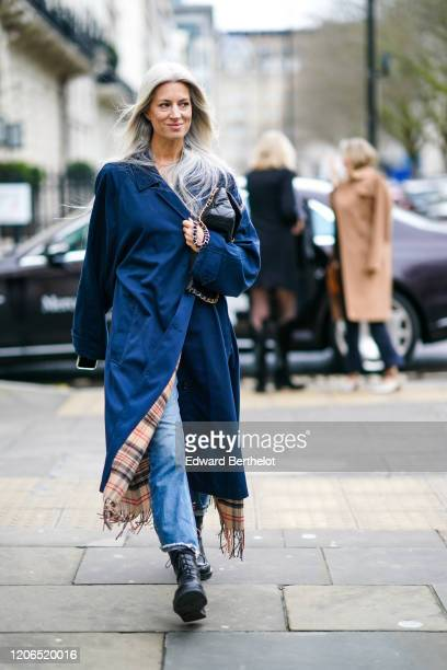 Sarah Harris wears a blue long coat a black quilted bag during London Fashion Week Fall Winter 2020 on February 15 2020 in London England
