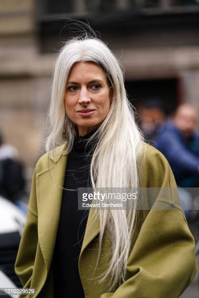Sarah Harris wears a mustardyellow oversized coat a black turtleneck outside Akris during Paris Fashion Week Womenswear Fall/Winter 2020/2021 on...