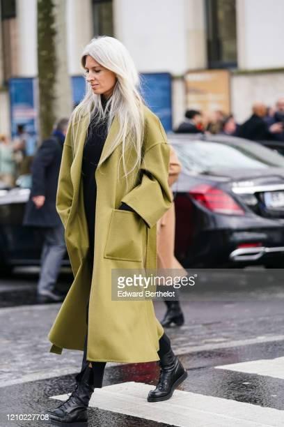 Sarah Harris wears a mustardyellow oversized coat black laceup boots outside Akris during Paris Fashion Week Womenswear Fall/Winter 2020/2021 on...