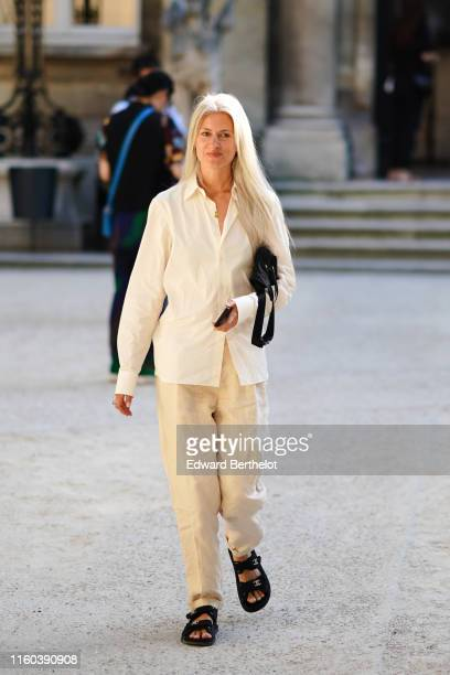 Sarah Harris wears a white shirt white pants sandals outside Valentino during Paris Fashion Week Haute Couture Fall/Winter 2019/2020 on July 03 2019...