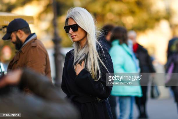 Sarah Harris wears sunglasses a black coat outside Alexandre Vauthier during Paris Fashion Week Haute Couture Spring/Summer 2020 on January 21 2020...