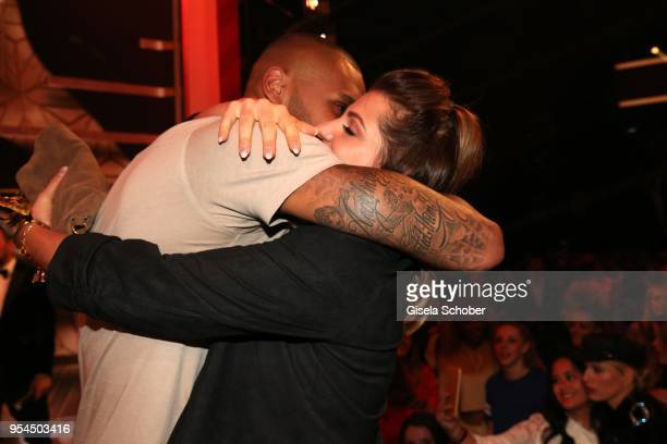 Sarah Harrison former Nowak and her husband Dominic Harrison @ dominikharrisonofficial with award kisses during the 2nd ABOUT YOU Awards 2018 at...