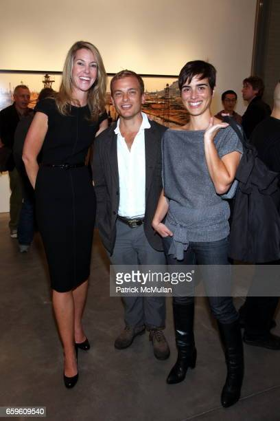 Sarah Hasted Christopher Anderson and Marion Durand attend EDWARD BURTYNSKY Artist Reception at HASTED HUNT KRAEUTLER on October 6 2009 in New York...