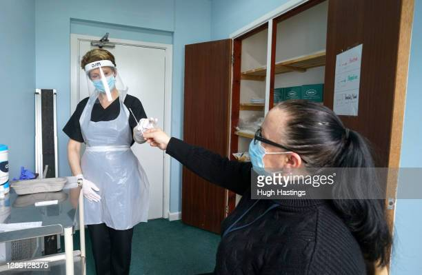 Sarah Hatchett, Head of Care at King Charles Court nursing home oversees a a demonstration on Manager Melissa Jones of a rapid Covid-19 test on...