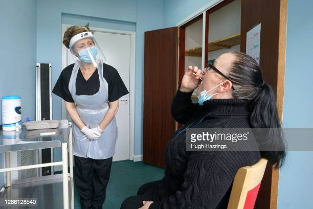 Sarah Hatchett , Head of Care at King Charles Court nursing home oversees the demonstration of a rapid Covid-19 test on Manager Melissa Jones on...