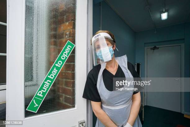Sarah Hatchett, Head of Care at King Charles Court nursing home prepares to oversee a rapid Covid-19 test on a member of staff on November 17, 2020...