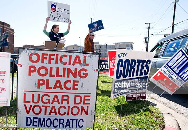 Sarah Hill left and Janet Mockovciak wave signs in support of Democratic presidential candidate Barack Obama outside a polling precinct in Dallas...