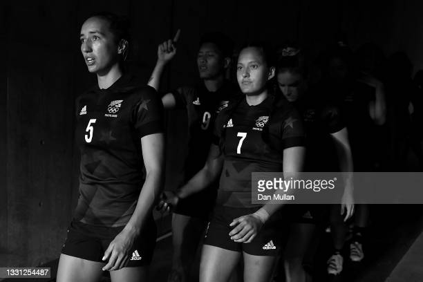 Sarah Hirini and Tyla Nathan-Wong of Team New Zealand walk out with their team before the Women's pool A match between Team New Zealand and Team...