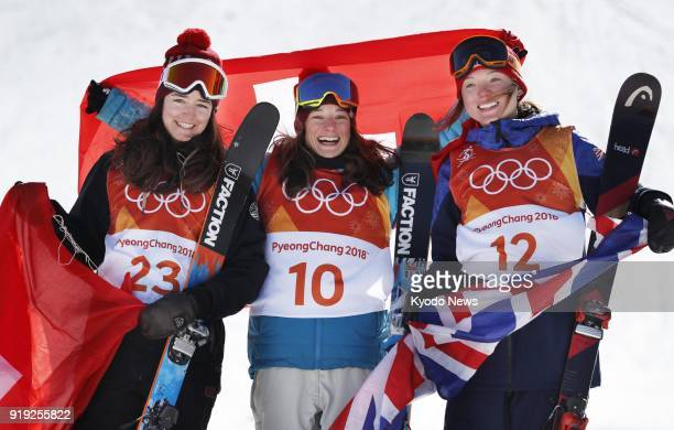 Sarah Hoefflin of Switzerland poses for photos after winning the gold medal in the women's skiing slopestyle at the Pyeongchang Winter Olympics in...
